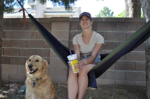 My wife getting some relaxing time with our golden retriever in the hammock