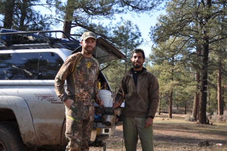 Justin and me with what was left of the deer after quartering and cleaning.